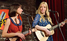 Kate Micucci and Riki Lindhome as Garfunkel and Oates